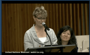 Ashton Applewhite holding her keynote speech at the UN
