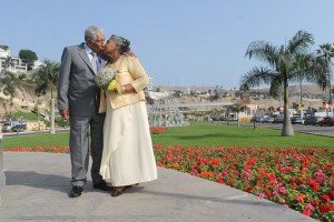 mature couple, walking in park, kissing